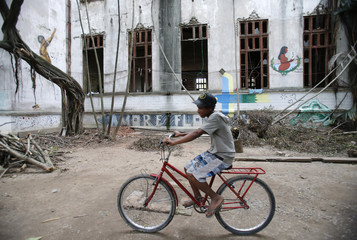 A boy rides his bicycle at the Indian Museum in Rio de Janeiro