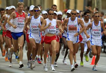 Roethlin from Switzerland runs to win the men's marathon final at the European Athletics Championships in Barcelona