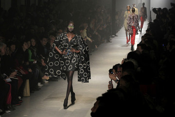 Models present creations by Vivienne Westwood as part of her Fall-Winter 2013/2014 ready-to-wear fashion collection during Paris Fashion Week