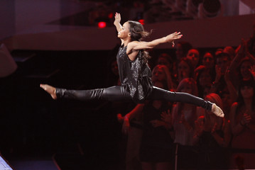"U.S. Olympian Gabby Douglas leaps during Alicia keys' performance of ""Girl on Fire"" during the 2012 MTV Video Music Awards in Los Angeles"