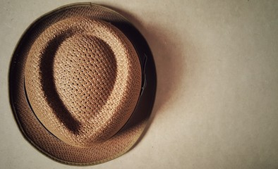 Brown fashion hat on the wood floor.