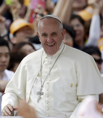 Pope Francis smiles as he arrives for the beatification mass of 124 Korean martyrs in Seoul