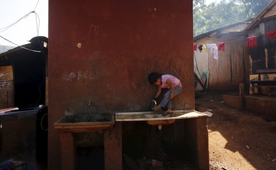 Guarani Indian girl washes her foot in the village of Pyau at Jaragua district, in Sao Paulo