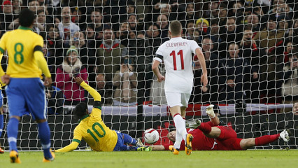 England's goalkeeper Joe Hart makes a double penalty save against Brazil's Ronaldinho during their international friendly soccer match at Wembley stadium in London