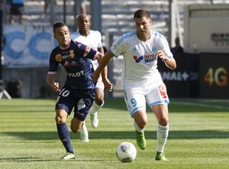 Olympique Marseille's Gignac challenges Evian Thonon Gaillard's Benezet during their French Ligue 1 soccer match in Marseille