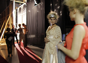 Models wait in the backstage for the start of a fashion show by Hungarian designer Bori Toth in Budapest