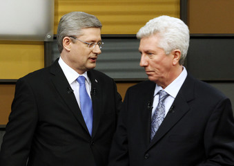 Canada's PM Harper and Bloc Quebecois leader Duceppe meet prior to the French language leaders' debate in Ottawa
