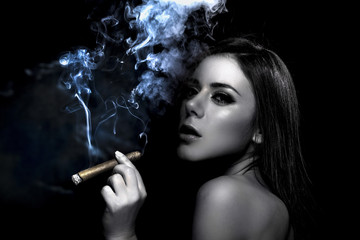 Portrait of a young woman smoking