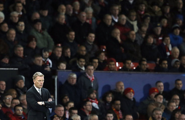 Manchester United's manager Moyes watches during their Champions League soccer match against Shakhtar Donetsk at Old Trafford in Manchester
