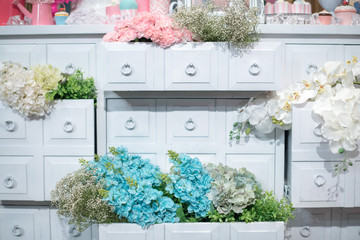 chest of drawers with an extended box and flowers. Design for decoration backdrop in valentine or wedding party event. pastel flower. Vintage style