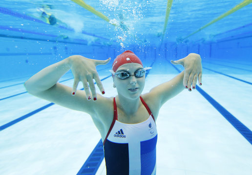 Applegate of Britain shows off manicured nails at pool during training session on third day of London 2012 Paralympic games