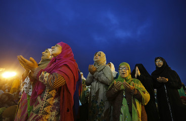 Kashmiri Muslim women pray during Meeraj-un-Nabi celebrations in Srinagar