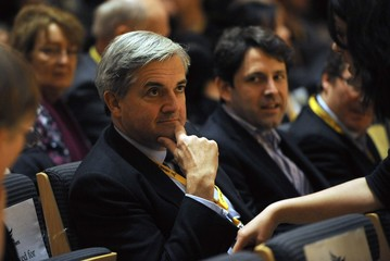 Former Energy Secretary Huhne listens as Britain's Deputy PM and leader of the Liberal Democrats, Nick Clegg, delivers his speech to delegates in Gateshead
