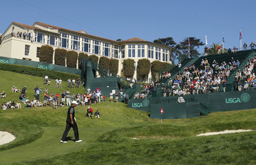 Tiger Woods of the U.S. walks to the 18th green with the clubhouse in the background during a practice round for the 2012 U.S. Open golf championship on the Lake Course at the Olympic Club in San Francisco