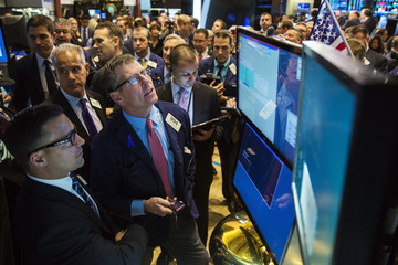 Traders wait for the IPO of STORE Capital on the floor of the New York Stock Exchange shortly after the opening bell in New York