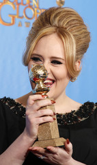 "Adele, winner for Best Original Song - Motion Picture, for ""Skyfall"" from the film of the same name poses with her award at the 70th annual Golden Globe Awards in Beverly Hills"