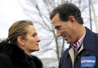 Republican presidential candidate and former Pennsylvania Senator Rick Santorum looks at his wife Karen before speaking at a campaign rally in Nashua