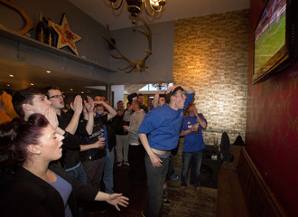 Chelsea fans react as they watch their team play Benfica in the Europa League final soccer match in London