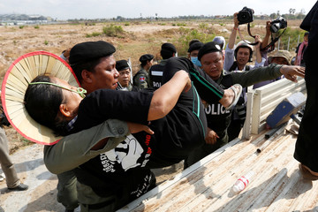 Cambodian police detain protesters during a protest to free jailed activists in Phnom Penh