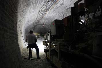 A worker steers a milling cutter in a pilot mine which is being tested for potential use as a permanent nuclear waste storage facility in Gorleben