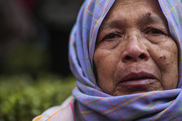 Farmer protester cries during a rally demanding the Yingluck administration resolve delays in payment, outside the Government's temporary headquarters in Bangkok