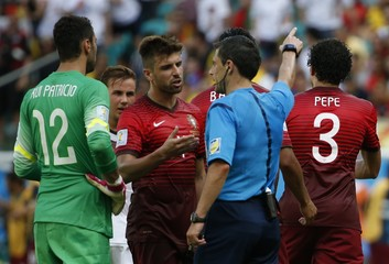 Portugal's Pepe is sent off by referee Mazic of Serbia as Portugal's goalkeeper Patricio and  Eder talk with Mazic during their 2014 World Cup Group G soccer match at the Fonte Nova arena in Salvador
