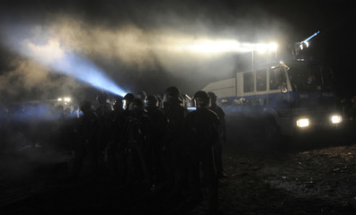 Police forces use water cannons against anti-nuclear demonstrators in Laase