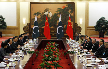 Pakistan's Prime Minister Yusuf Raza Gilani and China's Premier Wen Jiabao attend a meeting in Beijing