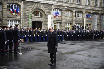 French President Francois Hollande attends a ceremony during a visit to the French anti-terror security forces at Paris police headquarters