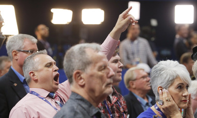 A Republican National Convention delegates yells as the Republican National Committee Rules Committee announces that it will not hold a recorded vote on the Rules Committee's Report in Cleveland