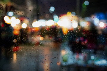Drop on window car with the rainy night city