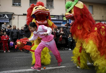 People perform during a parade to celebrate the Chinese Lunar New Year, which welcomes the Year of the Monkey, in Madrid, Spain