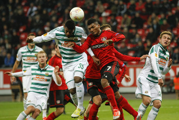 Bayer Leverkusen's Junior Fernandes and Rapid Wien's Gerson head a ball during the Europa League Group K soccer match in Leverkusen