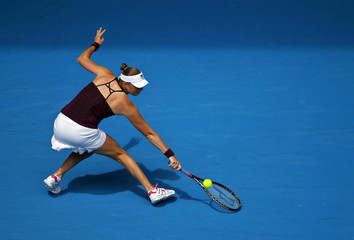 Zvonareva of Russia hits a return to Safarova of the Czech Republic during their match at the Australian Open tennis tournament in Melbourne