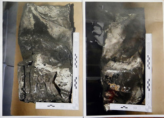 Two pictures showing the damaged black box data flight recorder are seen during a press conference given by French prosecutor in Marseille