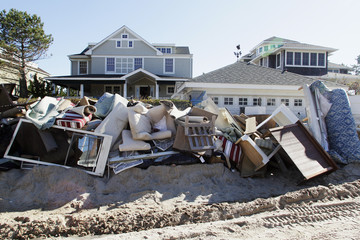 Water-damaged furniture and belongings are piled high on sand along East Avenue in the aftermath of Hurricane Sandy, at Bay Head