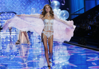 Model presents a creation at the 2014 Victoria's Secret Fashion Show in London