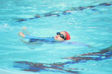 Children boy in swimming pool