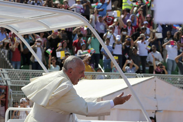 Pope Francis waves to the faithful upon his arrival to attend a mass at Amman