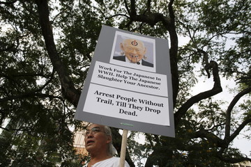 A protester holds up a placard as he joins in a protest to free blogger Amos Yee, at Hong Lim Park in Singapore