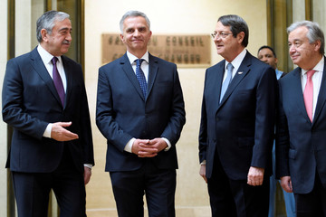 Swiss Federal Councillor and minister of Foreign Affairs Burkhalter, welcomes Turkish Cypriot leader Akinci, Cypriot President Anastasiades and UN Secretary-General Guterres before a conference in Geneva