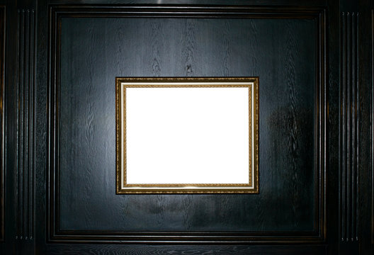 Empty gold frame on a black wooden background copy space