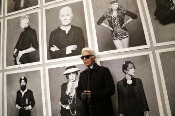 """Chanel's creative director Lagerfeld poses before the opening of his photo exhibition entitled """"Little Black Jacket"""" at the Grand Palais in Paris"""