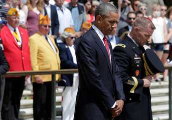 President Barack Obama participates in wreath-laying ceremony at the Tomb of the Unknown Soldier