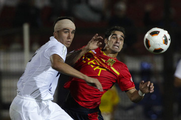Tobio of Argentina's Velez Sarsfield fights for the ball with Jaime of Chile's Union Espanola during their Copa Libertadores Soccer match in Santiago