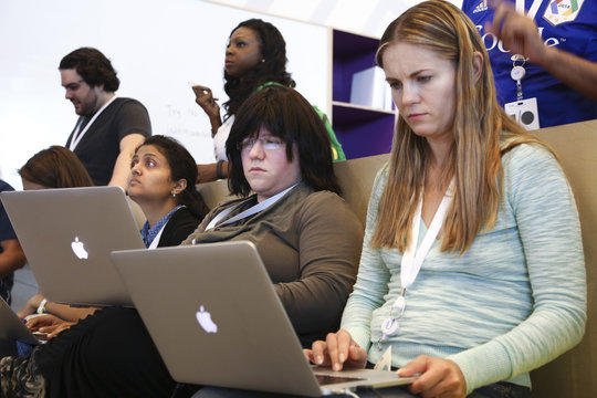 Women attendees use their laptops in a code lab at the Google I/O developers conference in San Francisco