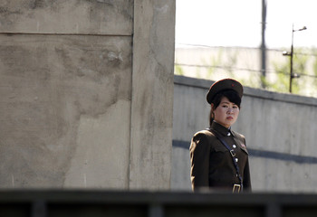 A North Korean soldier stands guard on the banks of Yalu River, near Sinuiju
