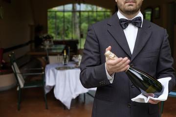 Waiter serving champagne flutes during a celebration