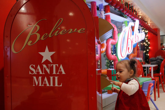 A child mails a letter to Santa at Macy's Herald Square in Manhattan, New York City