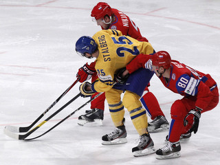 Sweden's Stalberg scuffles with Russia's Nikulin and Ketov during their 2012 IIHF men's ice hockey World Championship game in Stockholm